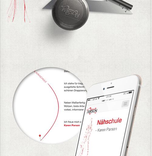 Detail des Webdesigns mit roten Überschriften und Designelementen sowie einspaltiges Layout auf einem Smartphone
