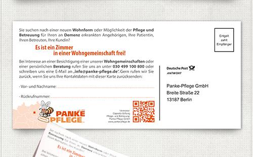 Gestaltung der Rückseite der Postkarte mit Informationen, kleiner Berlin Karte, QR-Code und Antwortmöglichkeit